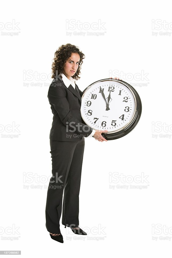 Angry business woman holding clock royalty-free stock photo