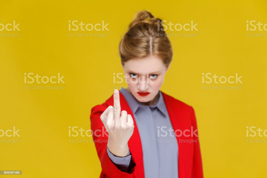 Angry business woman in red suit demonstrate fuck you sign. stock photo