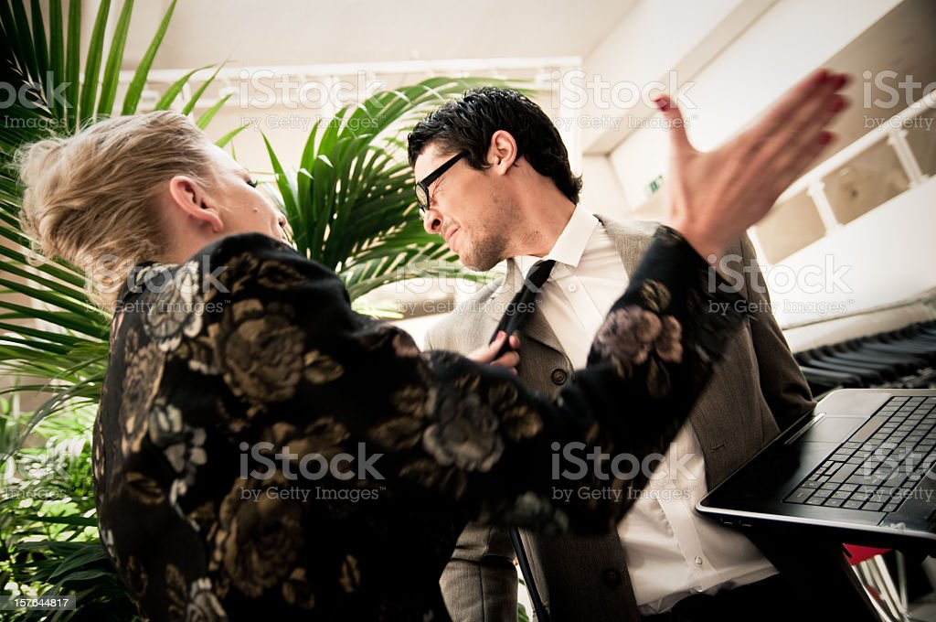 Angry Business Woman Slams Coworker stock photo