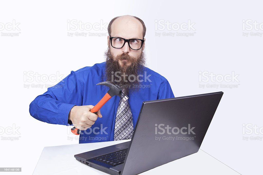Angry businessman and hammer - (Series) royalty-free stock photo