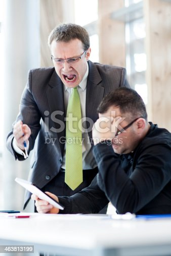 463813207 istock photo Angry businessman and his subordinate 463813199