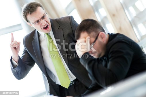 istock Angry businessman and his subordinate 463813207