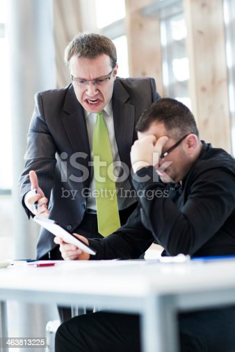 463813207 istock photo Angry businessman and his subordinate 463813225