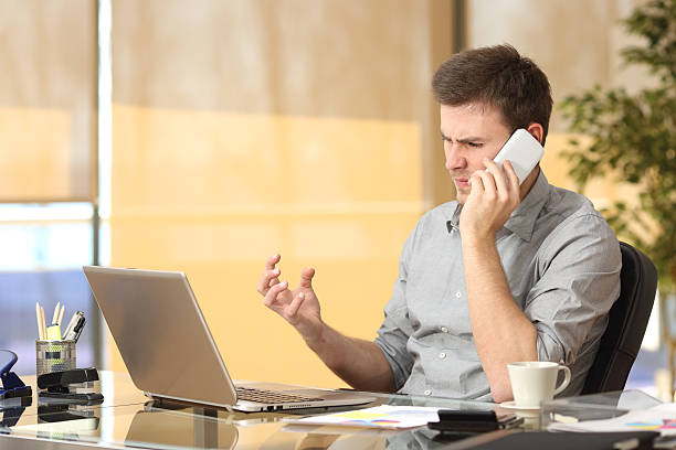 Angry businessman arguing on the phone stock photo