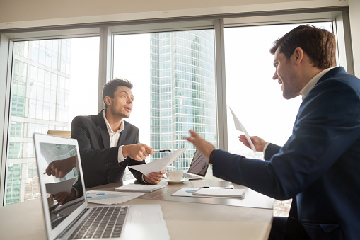 istock Angry businessman arguing with partner on meeting 845314188