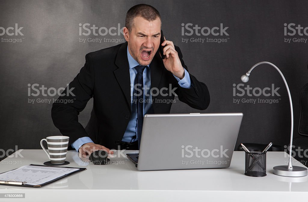 Angry businessman in office stock photo