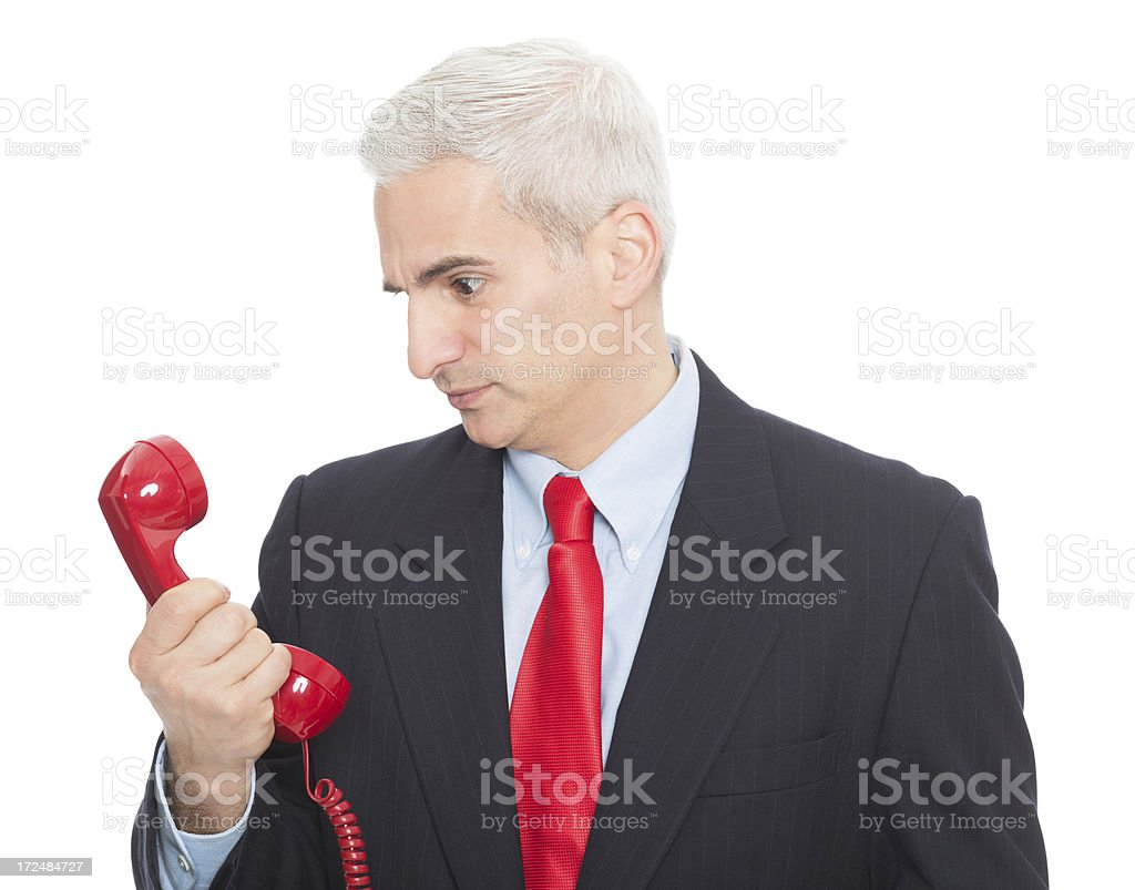 Angry Businessman Looking At Telephone royalty-free stock photo