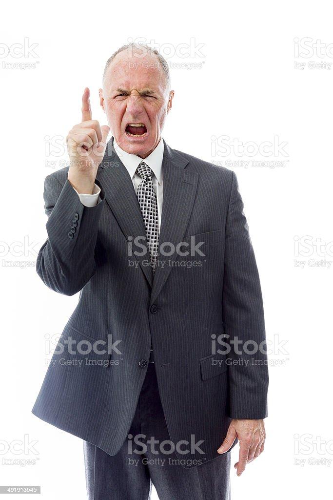 Angry businessman raising finger stock photo