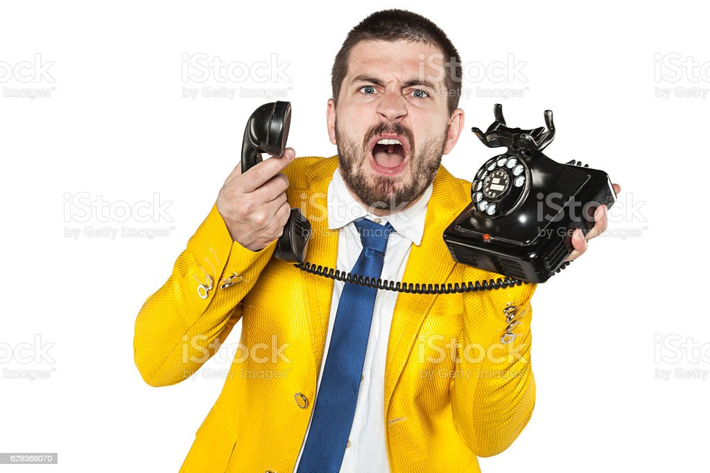 angry businessman screaming to the phone, funny facial expressio stock photo