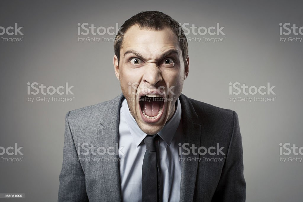 Angry businessman shouting stock photo