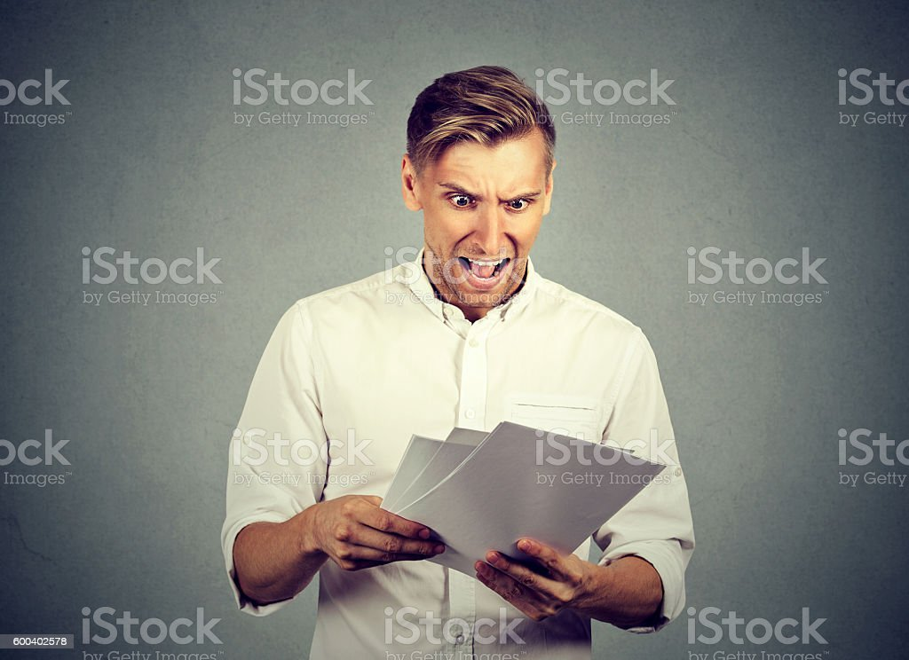 Angry businessman with documents stock photo