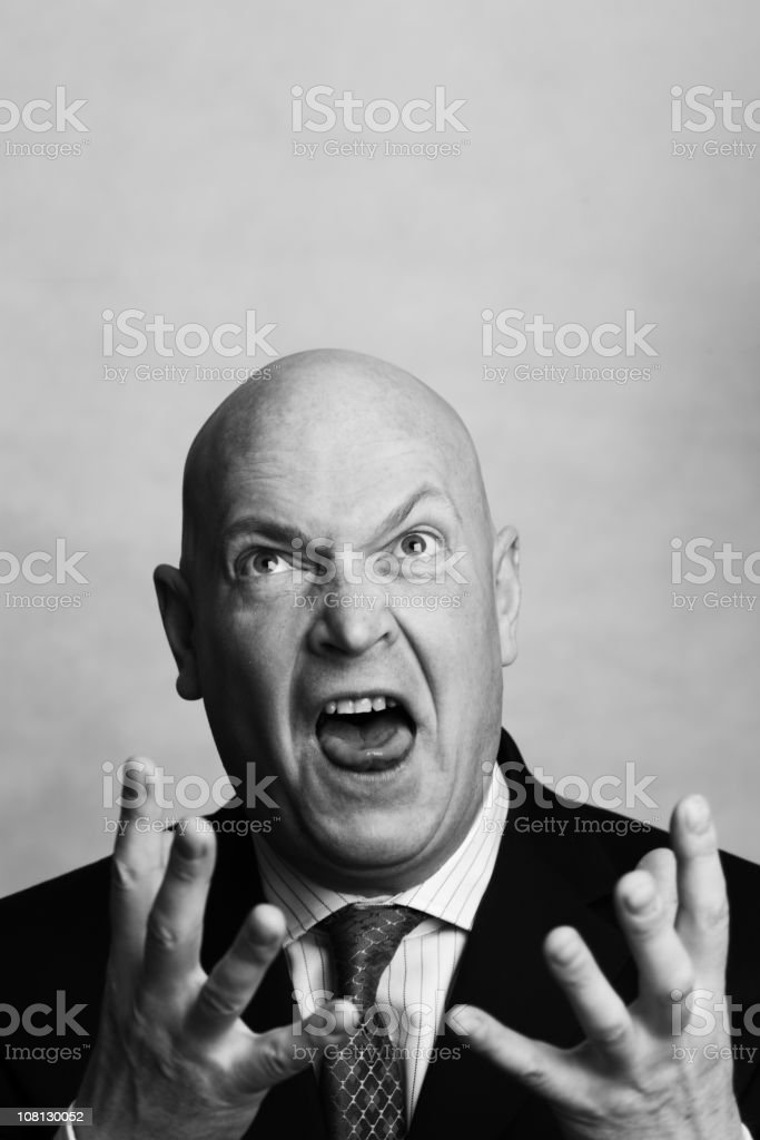Angry Businessman Yelling and Holding Hands in Air royalty-free stock photo