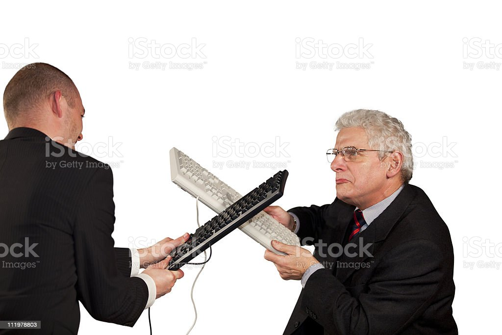 angry businessmen fighting with keyboards royalty-free stock photo