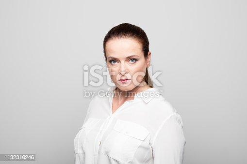 1132314350 istock photo Angry businesswoman against white background 1132316246