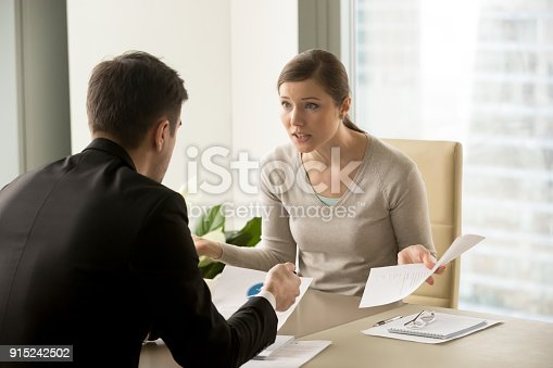 istock Angry businesswoman arguing with businessman about paperwork failure at workplace 915242502