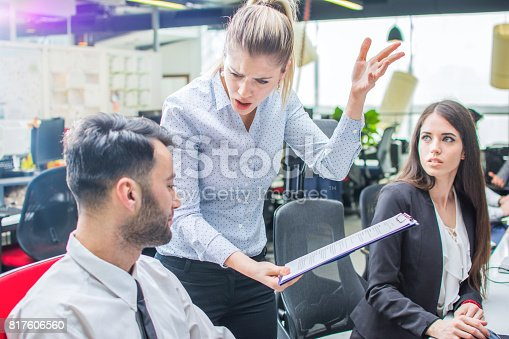 istock Angry businesswoman shouting to a stressed employee at office. 817606560