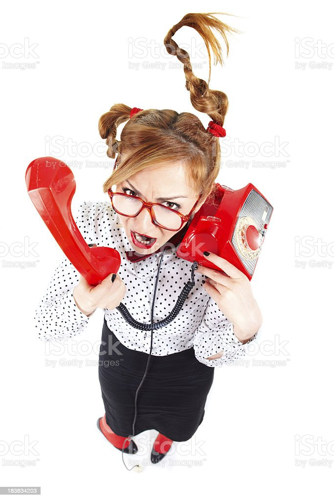 Angry businesswoman wearing glasses screaming on the phone royalty-free stock photo