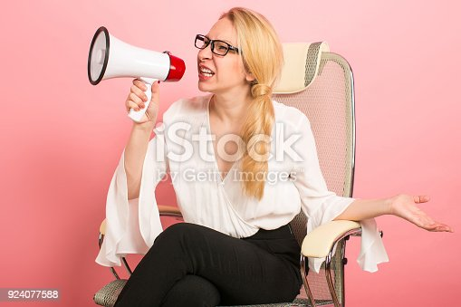 820421282istockphoto Angry businesswoman with loudspeaker 924077588
