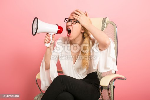 istock Angry businesswoman with loudspeaker 924254950