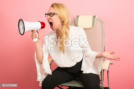 820421282istockphoto Angry businesswoman with loudspeaker 924255096