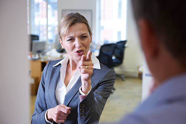 a angry businesswoman yelling at a male colleague - aggression stock pictures, royalty-free photos & images