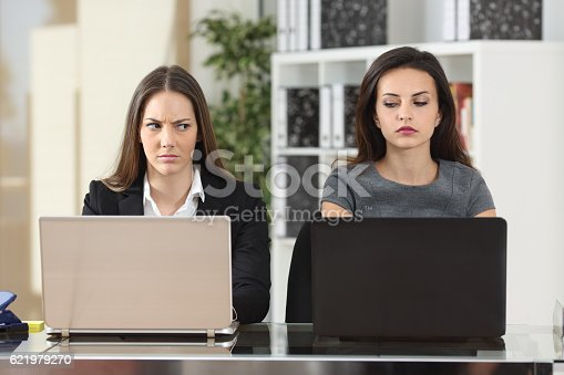 istock Angry businesswomen looking with hate 621979270
