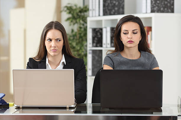 Angry businesswomen looking with hate stock photo