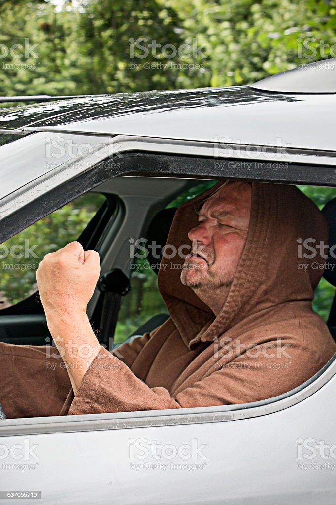 Angry car driving monk stock photo