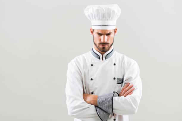 angry chef on gray background. - chef triste foto e immagini stock