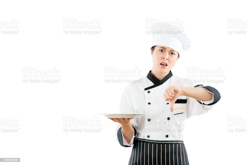 angry chef showing unhappy facial expressions stock photo
