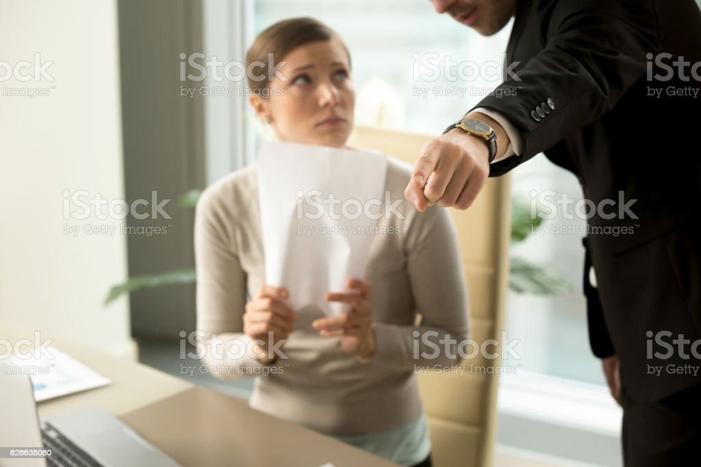 Angry chief firing dismissing subordinate, hand gesture close up view stock photo