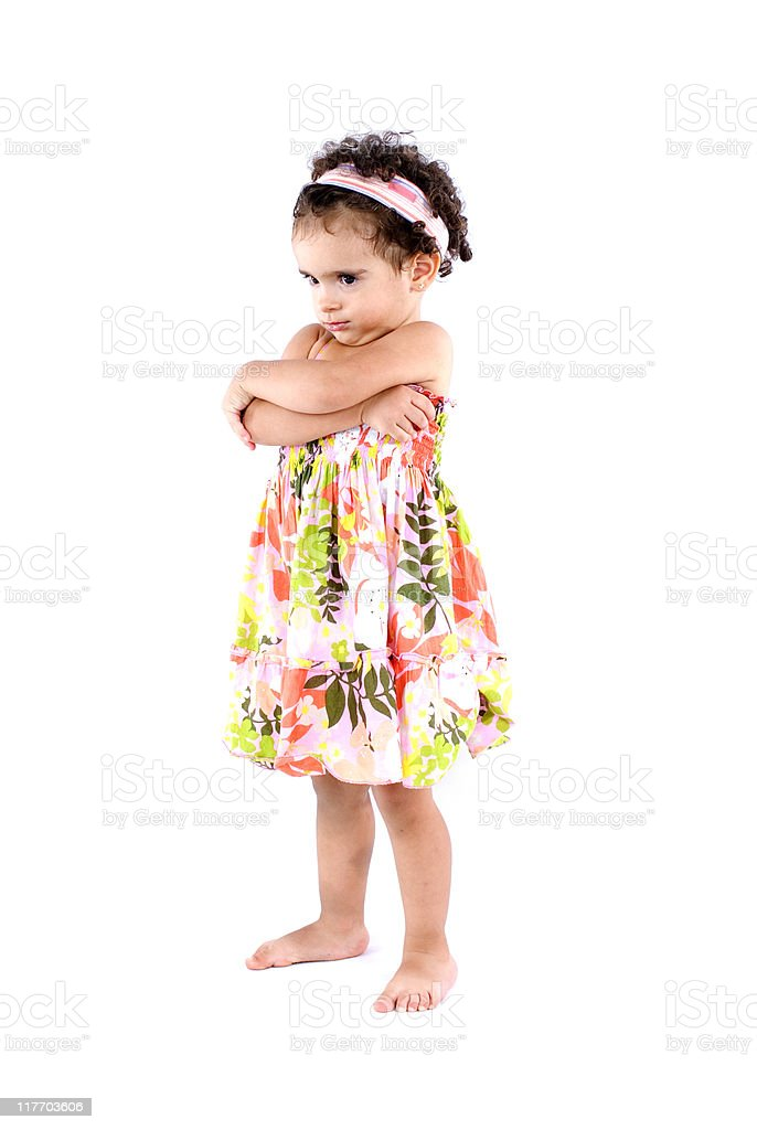 Angry child in a flowered dress isolated on white royalty-free stock photo