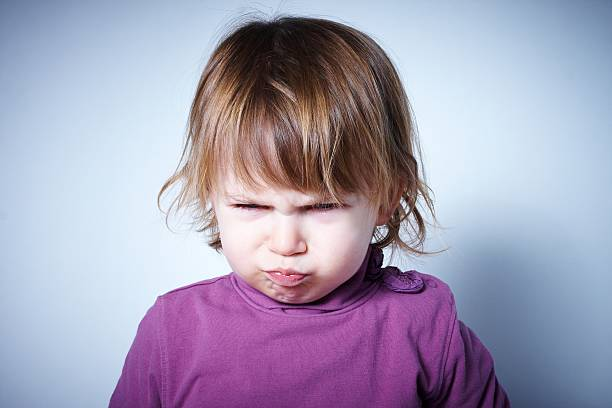 Angry child stock photo