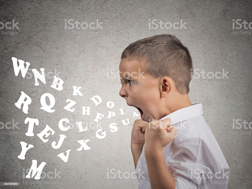 Angry child screaming stock photo