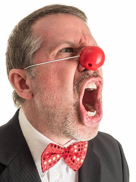 злая клоун в костюме и с криком. - presidential debate стоковые фото и изображения