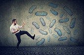istock Angry confident man fighting bacteria 1138293825
