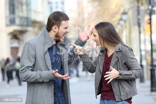 istock Angry couple arguing in the street 1094393232