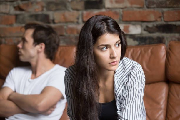 Angry couple avoiding talking after family fight stock photo