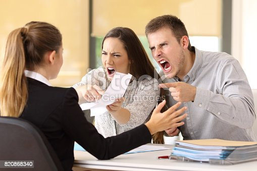 istock Angry couple claiming at office 820868340