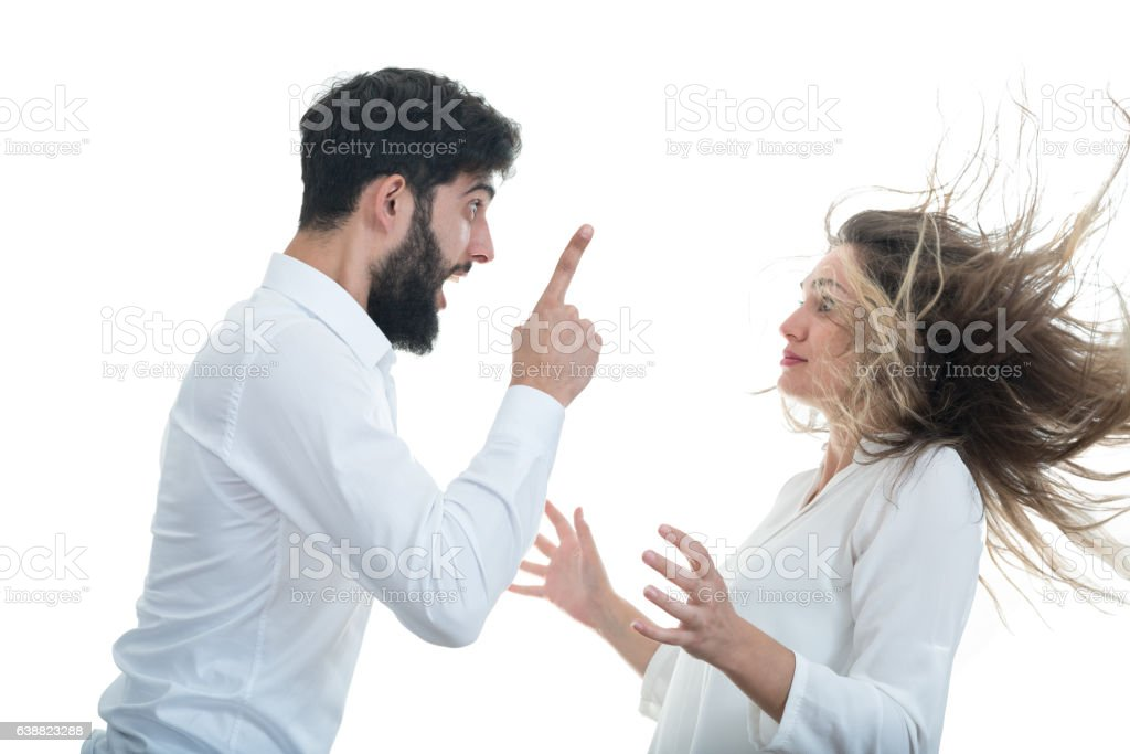 Angry couple shouting at each other on white background stock photo