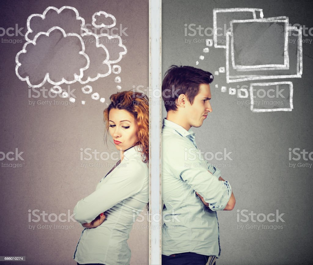 Angry couple thoughtful man and woman separated by wall stock photo