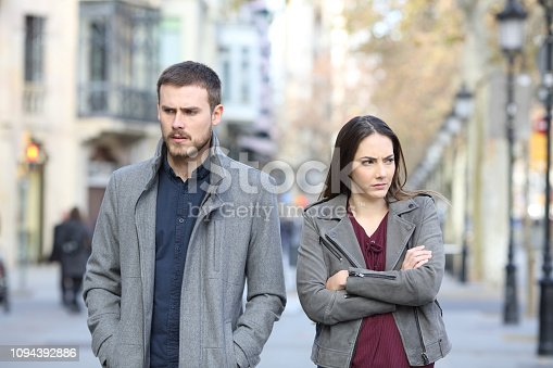istock Angry couple walking in the street after argument 1094392886