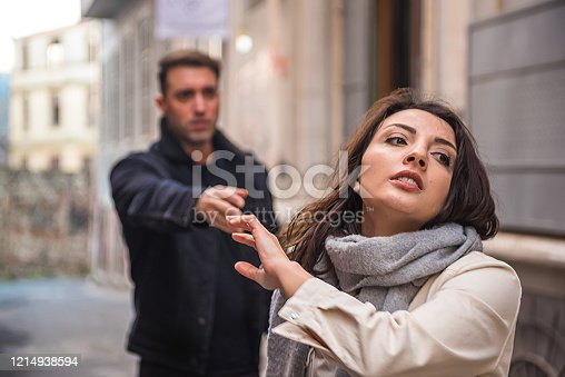 680684660 istock photo Angry couple yell to each other outside 1214938594