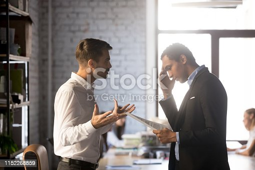 istock Angry director criticizing financial report accusing african man employee 1152268859