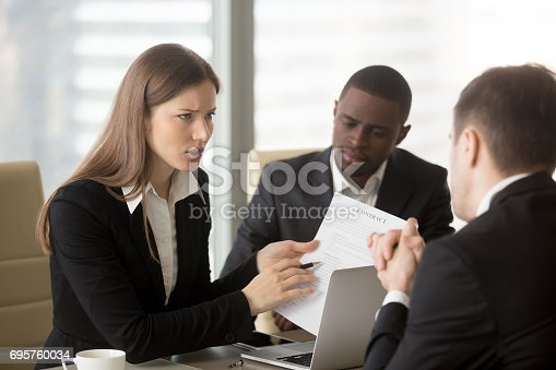 istock Angry dissatisfied businesswoman arguing with contractor, pointing at contract 695760034