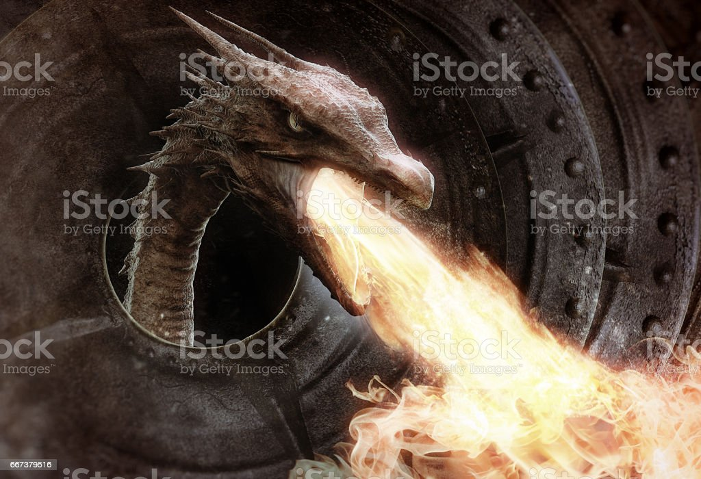 angry dragon spitting fire stock photo