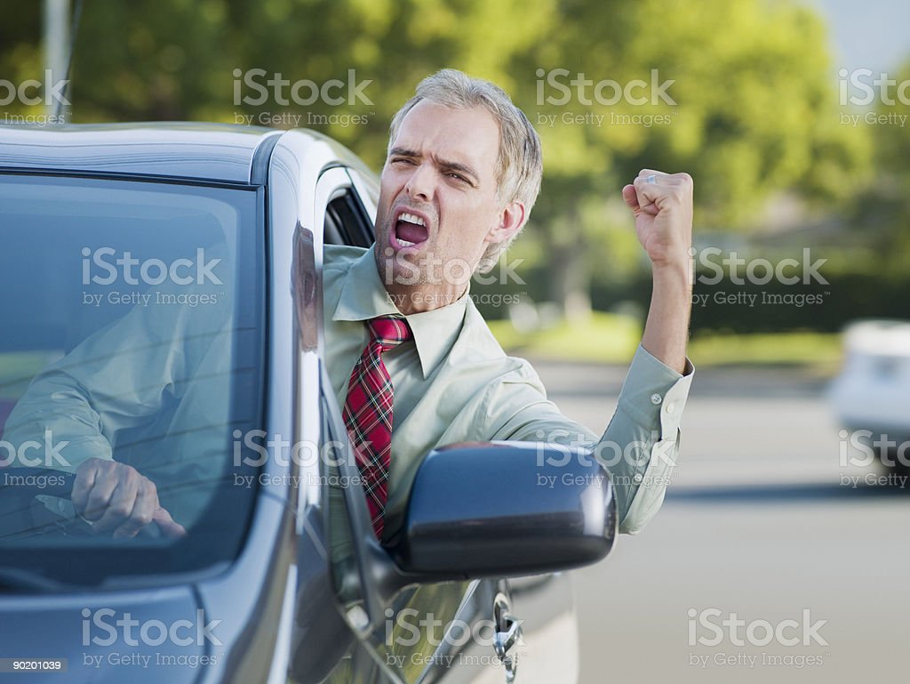 Angry driver shouting out car window stock photo