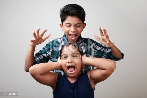 istock Angry elder brother attacks his sister 911347878