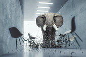 Angry elephant in the office. This is entirely 3D generated image.