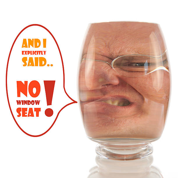 Angry face locked up in glass with comment stock photo